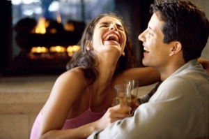 Side profile of a young couple laughing